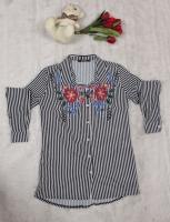 A long women s shirt with beautiful patterns
