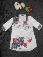 A long women s shirt with a beautiful collar