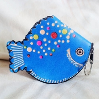 A beautiful medallion and a coin purse - a fish