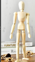 A moving wooden figure for painters