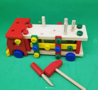 Car wood with hammer tools and screwdriver to encourage children to p their abilities and hobbies