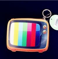 A small children s wallet shaped like a television