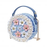 A round-shaped baby bag with flowers