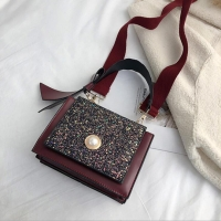 Women handbag with average size of glistening