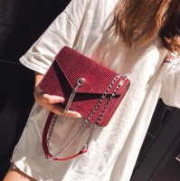 Women s handbag with shiny fabric