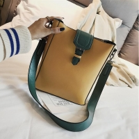 Women handbag containing makeup bag