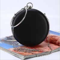 Women s handbag has a round handle and a metal strap