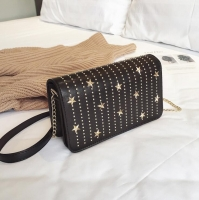 Women handbag containing metal star beautiful