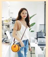 Women hand bag circular shape
