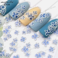 Colored nail stickers in the form of 3D flowers