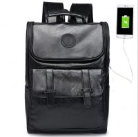 Men s backpack with a large size of the skin contains a charger port