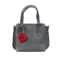 Women bag with fur ball