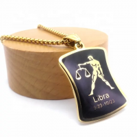 Metal pendant in the shape of a Libra man
