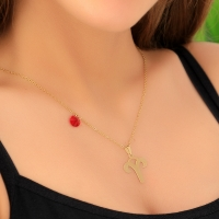 A women's necklace in the form of the symbol of Aries