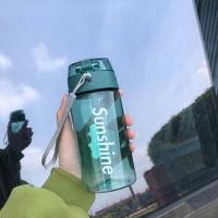 Transparent green water bottle