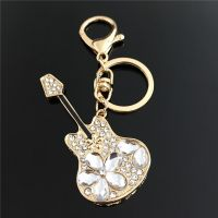 Keychain - guitar - studded with Rhine stone