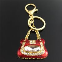 Keychain - beautiful   bag - gold-plated - studded with crystals