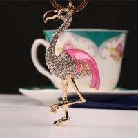 Keychain - the form of stork - inlaid with Rhinestone