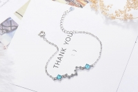 Women's 925 silver bracelet decorated with white and blue crystals