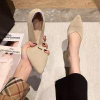 Women shoes in beige color flat