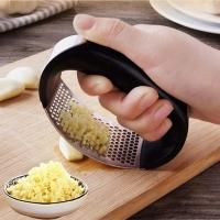 Manual garlic masher