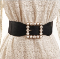A women's belt decorated with pearls